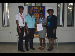 Victoria Campbell (second right), grade-11 student of Mt Alvernia High School and member of the Custom-Made Optimist Club,with her award. From left are Jacinth Mighty, president of the club; Richard Robinson, lieutenant-governor of the Optimist International Club's Caribbean District Zone Four; and Michelle Bryan, new club building chairperson of the Optimist International Club's Caribbean District.