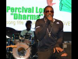 Wild card Percival Lord, aka Dharma, performing his entry song, 'A Jamaica We Love', at the  2019 Jamaica Festival Song competition launch held at  Emancipation Park last Thursday.
