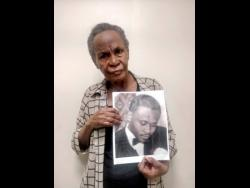 Esther Cunningham shows a photo of her brother Percy.