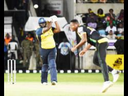 St Lucia Zouks batsman Rahkeem Cornwall (left) plays a stroke off Jamaica Tallawahs pace bowler Oshane Thomas' delivery during their Caribbean Premier League match at Sabina Park on Thursday, September 12, 2019.