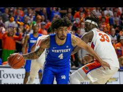 Kentucky forward Nick Richards drives during the second half of an NCAA college basketball game against Florida on Saturday, March 7, 2020, in Gainesville, Florida.