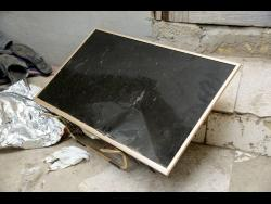This flat screen television is among the items that fleeing Trench Town residents say were destroyed by vandals.