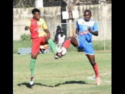 Humble Lion's Shamar Rhoden (left) goes into a 50-50 challenge with Portmore United's Rondee Smith during a Red Stripe Premier League match at the Spanish Town Prison Oval on Sunday, January 5.