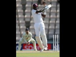 Windies captain Jason Holder bats during the fifth day of the first cricket Test match against hosts England at the Ageas Bowl in Southampton on Sunday.