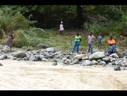 Residents of Orange Tree in St Thomas have been left stranded after their footbridge was washed away by flood waters.
