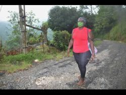 Donna Emmanuel-Mitchell on her five-mile journey from Bethel Gap to her Albion Mountain in St Thomas on Wednesday.