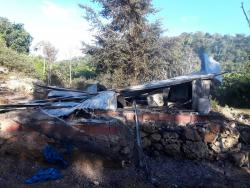 This house was burnt by residents following the shooting death of Glester White in St D'Acre, St Ann, yesterday.