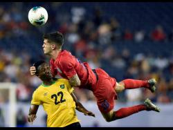 United States midfielder Christian Pulisic (10) heads the ball above Jamaica midfielder Devon Williams (22) during the second half of a Concacaf Gold Cup semifinal soccer match Wednesday, July 3, 2019.