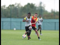 File Tiffany Cameron dribbles away from teammate Toriana Patterson during Reggae Girlz training session in Reims, France on June 10, 2019.