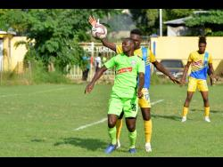File Harbour View FC's Damion Thomas battles for the ball with Molynes United's Romario Campbell in a Premier League match at the Constant Spring Football Field on November 27, 2019.