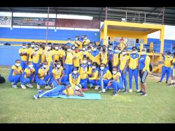 Members of the St Elizabeth Technical High School athletics team pose for a photograph at the STETHS Sports Complex yesterday.