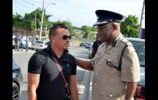 Bishop Dr Gary Welsh (right), assistant commissioner of police in charge of the Public Safety and Traffic Enforcement Branch, speaks with Dennis Dietrih yesterday.
