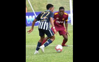 Nickari Campbell (left) of Jamaica College tries to get by Christopher Matthews of Wolmer's Boys School in a ISSA/Digicel Manning Cup game at Stadium East on Monday, September 16, 2019. The game was called off after five players were reportedly struck by lightning.