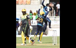 Members of the  Barbados Tridents  team celebrate the dismissal of Jamaica Tallawahs batsman Dwayne Smith during a Caribbean Premier League (CPL) match on September 15.