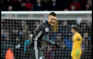 Leicester's Jamie Vardy smiles after scoring his side's fourth goal during the English Premier League match between Aston Villa and Leicester City at Villa Park in Birmingham, England,  yesterday.