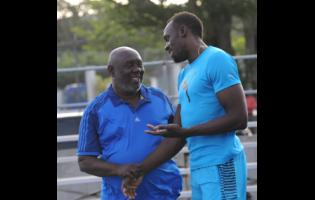 Usain Bolt (right) with his former coach coach Glen Mills.