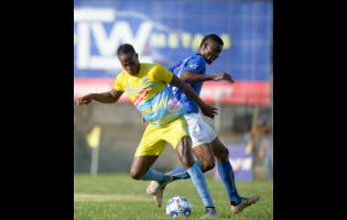 Waterhouse's Stephen Williams shields the ball from Anjay Gayle of Vere United during their Red Stripe Premier League encounter at Drewsland on September 12, 2019.