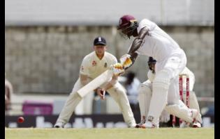 Windies' captain Jason Holder  plays a shot against England during day three of their first Test match at the Kensington Oval in Bridgetown, Barbados, last January.