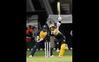 Jamaica Tallawahs batsman Glenn Phillips (right) in action against the St Lucia Zouks in the Caribbean Premier League at Sabina Park on Thursday, September 12, 2019.