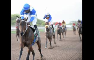 Wow Wow (left) ridden by Robert Halledeen wins the 10th race over 1300 metres at Caymanas Park on Sunday, July 5, 2020.