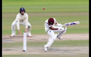 West Indies' Shane Dowrich evades a rising delivery from England's Jofra Archer during the fifth day of the third cricket Test match between England and West Indies at Old Trafford in Manchester, England, Tuesday, July 28, 2020.