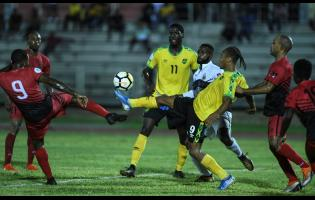 File Jamaican striker Bobby Reid controls the ball ahead of Antiguan Tevaughn Harriette in a nation's league match on September 6, 2019.