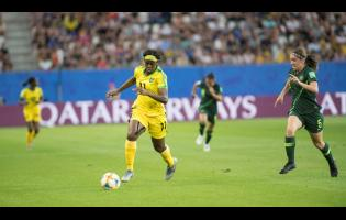 Khadija Shaw (left) dribbles away from Australia's defender Karly Roestbakken in a FIFA Women's World Cup match last year.