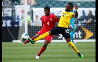 Jamaica's Junior Flemmings (right) in action for Jamaica during a CONCACAF Gold Cup match against Panama.