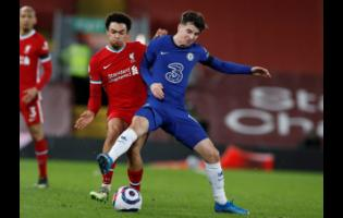 Chelsea's Mason Mount (right)  challenges for the ball with Liverpool's Trent Alexander-Arnold during the English Premier League match between Liverpool and Chelsea at Anfield stadium in Liverpool, England, yesterday.
