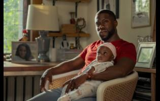 This image released by Netflix shows Kevin Hart in a scene from 'Fatherhood'.
