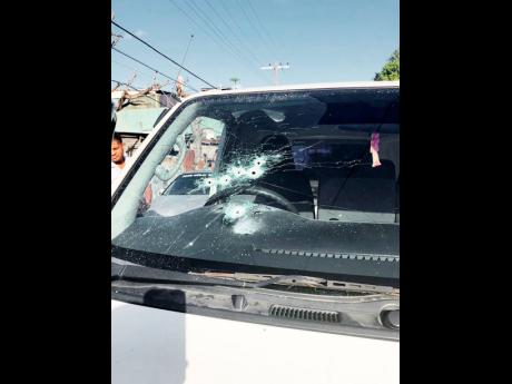 The windscreen of the courier van was riddled with bullets as the driver and a security guard were cut down by robbers in Montego Bay on Sunday.