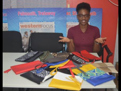 Entrepreneur Sashalyn Haye showcases the various styles and designs she offers in her Khandhor's Kweenz business.