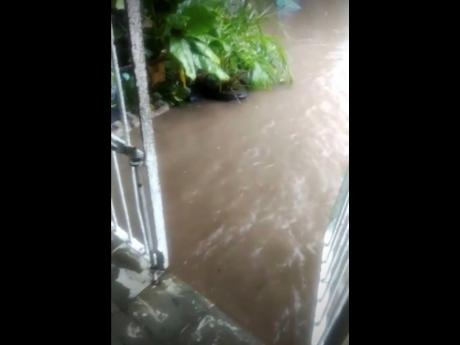 Flooding at a house in Cockburn Gardens due to heavy rainfall.