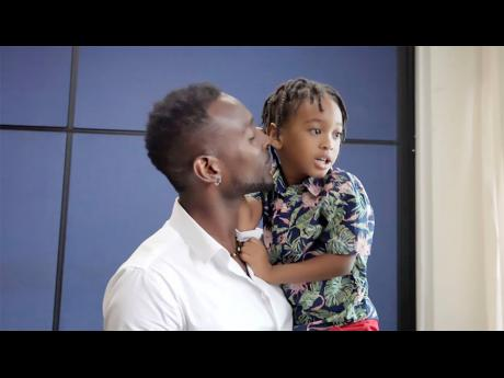 Dwayne Stewart holds his son, Soul-Heart.