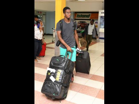 Demish Gaye at the Norman Manley International Airport last night after his arrival from the IAAF World Championships held in Doha, Qatar.