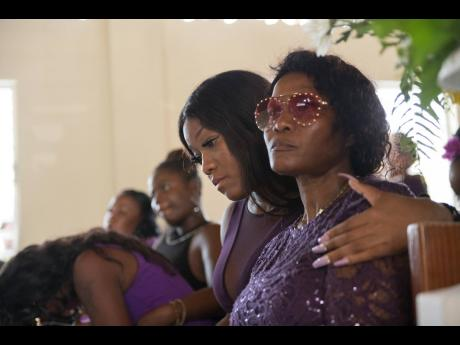Kimone Edwards, Twayne's sister, tries to comfort their mother, Marie Chambers Garvey.