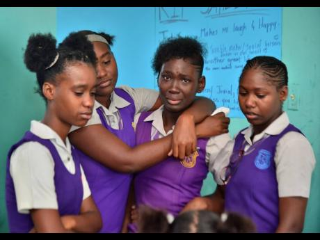 Students from the Ascot High School mourn the loss of their peer, Jahiem Palmer, who was killed on Sunday.