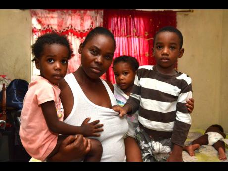 Kerry-Ann Anderson with three of her children.