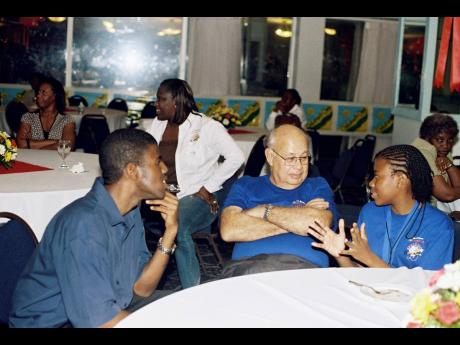Oliver Clarke (centre) loved The Gleaner's Children's Own Spelling Bee competition. Here at the 2007 champions' dinner, he listens keenly to Lawre Johnson, who was runner-up that year, and Daniel Thomas, 2001 winner.