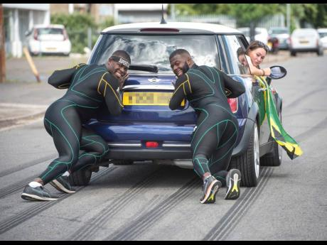 Jamaica bobsledders Nimroy Turgott (left) and Shawayne Stephens (right) push a car around Peterborough in the United Kingdom as they try to stay fit during coronavirus lockdown.