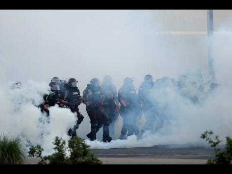 Police move toward demonstrators.