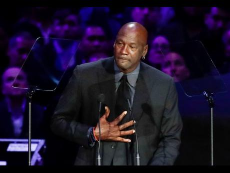 FILE - In this February 24, 2020, file photo, former NBA player Michael Jordan reacts while speaking during a celebration of life for Kobe Bryant and his daughter, Gianna,  in Los Angeles.
