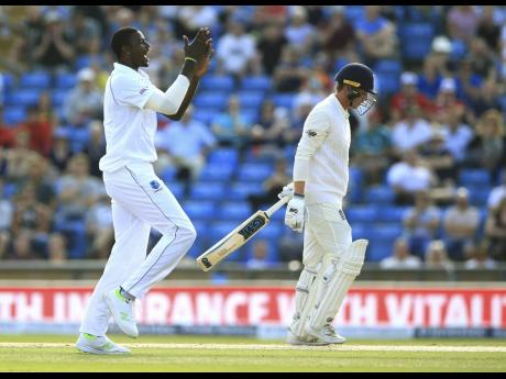 West Indies Jason Holder celebrates after taking the wicket of England's Tom Westley during day three of the second cricket Test match at Headingley, Leeds, England, Sunday, August 27, 2017.