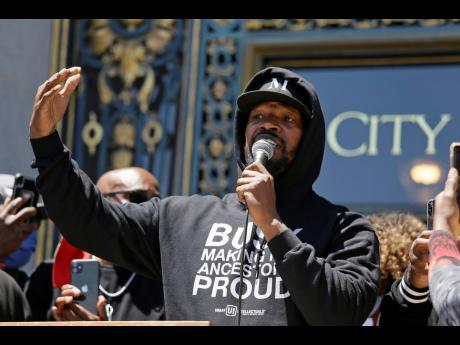 """Jamie Foxx speaks to a large crowd during a """"kneel-in"""" to protest police racism on the steps of City Hall in San Francisco, California, yesterday."""