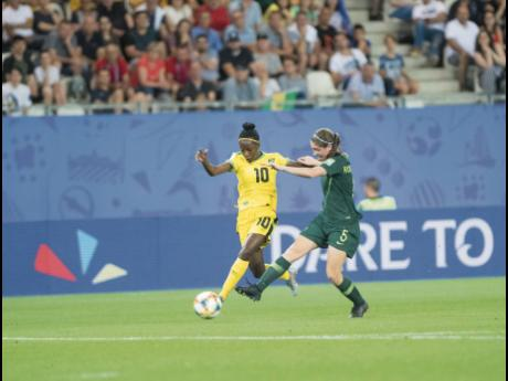 File Jody Brown (left) moves past Australia's Karly Roestbakken in the FIFA Women's World Cup in 2019.