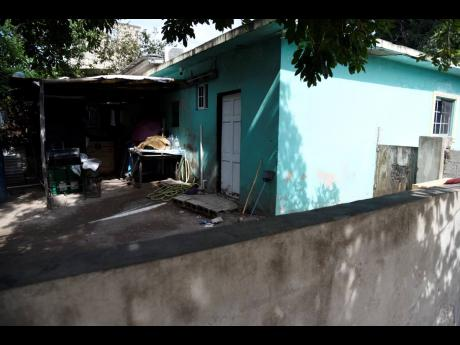 The yard of the house in which Ellia Pascoe and her daughter Notoya were murdered on Sunday.