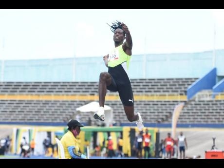 World Champion long jumper Tajay Gayle in action at the JOA/JAAA Olympic Destiny Series at the National Stadium on Saturday.